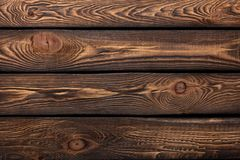 Texture of boards of dark old brown wood. Texture of old dark-tone boards in high resolution Royalty Free Stock Photo