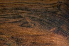Texture of Brazilian Rosewood, used as background Royalty Free Stock Photos