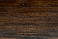 Texture of Brazilian Rosewood, used as background. Texture of Brazilian Rosewood, Endangered Species of Wild Flora, used as background stock photography