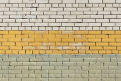 Texture a brick three color wall Royalty Free Stock Image