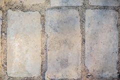 The texture of the brick for walkways. gray , pictured three bricks of rectangular shape royalty free stock photography