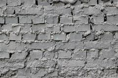 Texture of a brick wall with cement saggings between blocks coated with gray paint. As a background stock photography