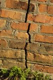 Texture - brick wall with a crack red stock photography