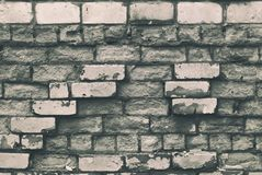 Texture of aged brick wall with cracked weathered structure white gray color close-up. Texture of brick wall with cracked weathered structure white gray color royalty free stock photography