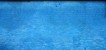 The texture of the brick wall of many rows of bricks painted in blue colo. R stock image