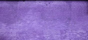 The texture of the brick wall of many rows of bricks painted in violet colo. R royalty free stock photos