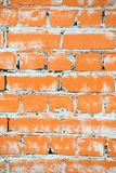 Texture of a brick wall painted with orange paint royalty free stock photos