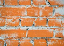 Texture of a brick wall painted with orange paint royalty free stock image