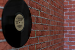 Texture brick wall with shellac. The record hanging on a brick wall stock photos