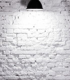 Texture of brick whitewashed wall with lamp on top Royalty Free Stock Photography