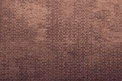 Texture of an bricklaying in dark brown tones Royalty Free Stock Image