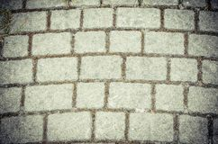 Texture with bricks. Gray concrete pavement tiles royalty free stock images