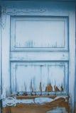 Texture of bright blue old wooden door. Paint peeling off Stock Photo