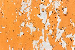 Texture of bright orange paints shabby metal wall stock photo