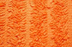 Texture of bright orange terry towels very closeup Stock Photos