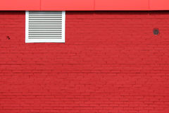 texture of bright red brick wall with white grille on a sunny day. Royalty Free Stock Photos