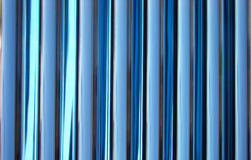 Texture from brilliant blue pipes. Heat-exchange equipment Stock Photos