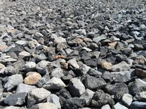The texture of broken rock arranged as a road foundation royalty free stock photo