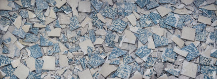 Texture from broken tiles. Background from fragments of old broken retro floor. Concept for renovation and modernization of floors and tiling royalty free stock image