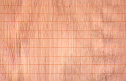Texture of brown bamboo tablecloth close up. Royalty Free Stock Photography
