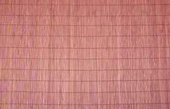 Texture of brown bamboo tablecloth close up. Stock Photo