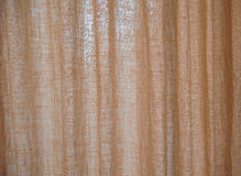 Texture brown burlap curtains Stock Images