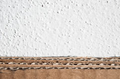Texture of brown cardboard side. Folded cardboard boxes against Royalty Free Stock Photos