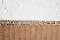 Texture of brown cardboard side. Folded cardboard boxes against Royalty Free Stock Image