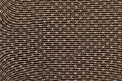 Texture of brown fabric with an abstract pattern Royalty Free Stock Photography