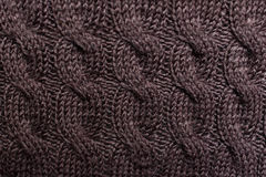 Texture of brown knitted wool sweater with ornament Royalty Free Stock Images