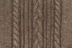 Texture of brown knitted wool sweater with ornament Royalty Free Stock Photography