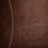 Texture of brown leather background with stitched seam, close-up. Stock Photos