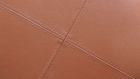 Texture of brown leather with light brown stitching in cross pattern. Useful for background design Royalty Free Stock Image