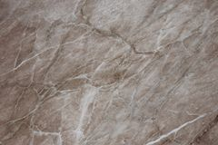Texture of brown marble slab. Abstract marble brown pattern. Vintage background. Old dirty wall texture. Interior detail. Antique royalty free stock photo