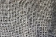 Texture of brown old canvas, linen natural material with a coarse perpendicular interlacing of the fibers of the fabric. The background stock photography