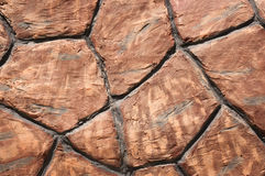 Texture of brown stone wall Royalty Free Stock Images