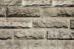Texture of brown stone wall background structure Stock Photos