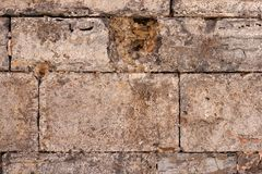 Texture of a brown stone wall Royalty Free Stock Photography