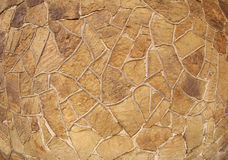 The texture of brown stone wall. Of large stones of irregular shape royalty free stock photo