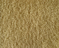 Texture of brown terry cloth fabric stock images