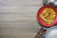 Texture brown wooden for background consist of omelet, rice and other side dishes. Copy space stock image