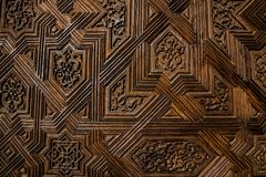 Texture of a wooden door with symmetrical patterns. Texture of a brown wooden door with symmetrical patterns Royalty Free Stock Images