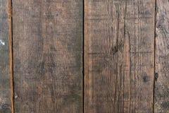 Texture brune en bois de grain, fond foncé de mur Images libres de droits
