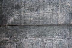 Texture brune en bois de grain, fond foncé de mur Photographie stock libre de droits