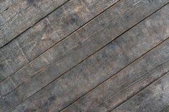 Texture brune en bois de grain, fond foncé de mur Photos libres de droits