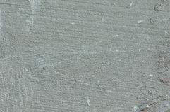 Texture - Brushed Concrete. The gray texture of the surface of concrete showing the strokes of the broom finishing the surface of the concrete when it was poured Stock Photography