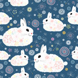 Texture of the bunnies. Seamless pattern of decorative fluffy bunnies on blue floral background Stock Photography