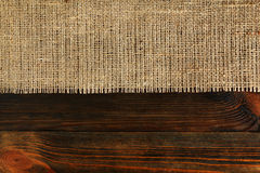 Texture of burlap bordered. With old wood background Royalty Free Stock Photos