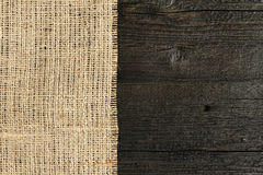 Texture of burlap bordered. With old wood background Stock Image
