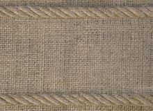 Texture of burlap with cord rope. Template frame of coarse cloth background stock photography